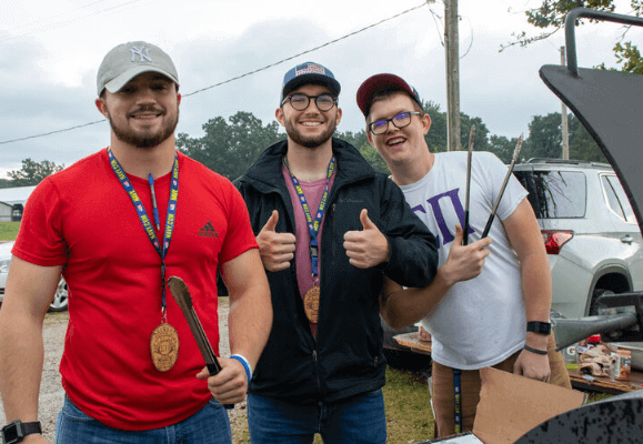 Sigma Pi Alpha Iota Chapter 3 brothers at an event