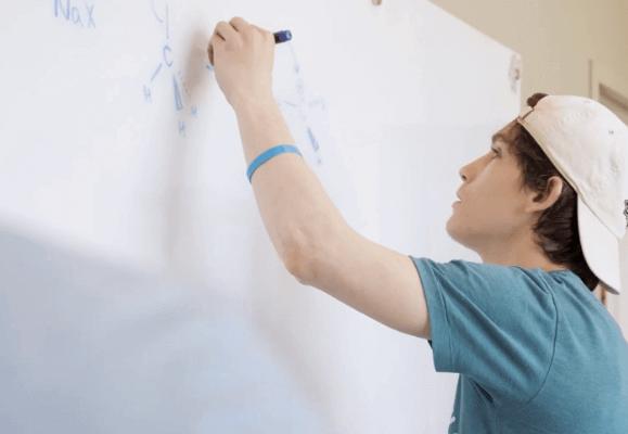 Sigma Pi Alpha Iota Chapter working on whiteboard
