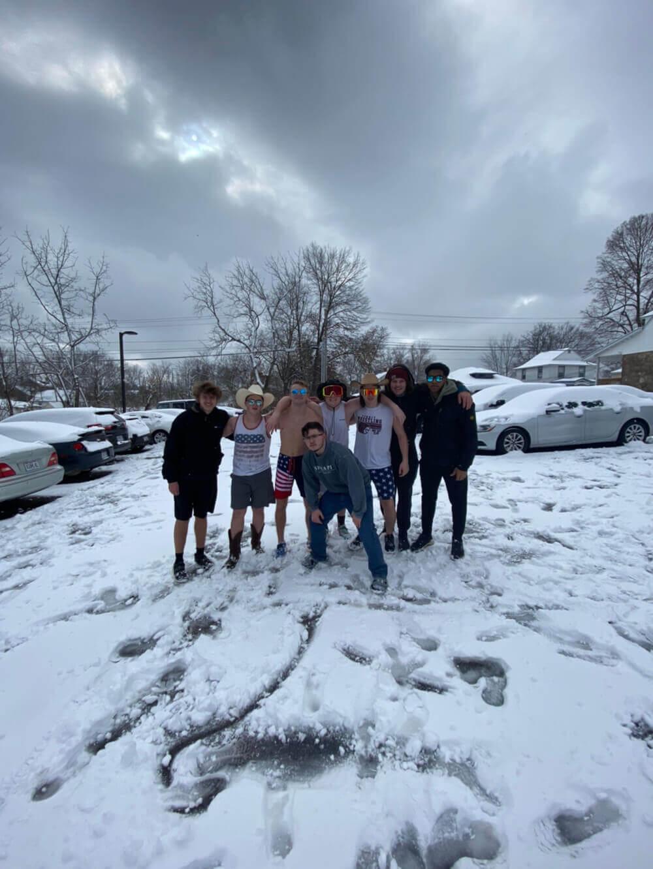 Sigma Pi Alpha Iota Chapter parking lot snow